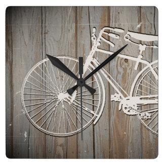 Bicicleta del vintage en arte rústico de la pared  reloj cuadrado