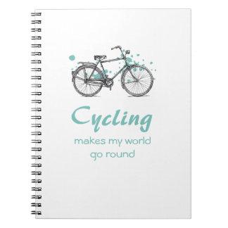 Bicicleta del vintage que dibuja el cuaderno espir