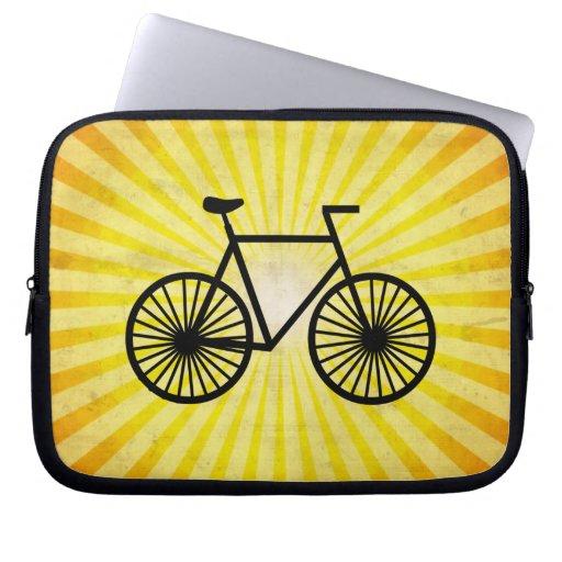 Bicicleta negra; Fondo amarillo Funda Computadora
