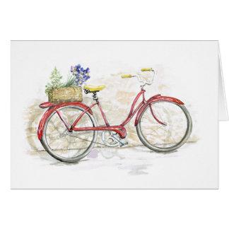 Bicicleta roja con la cesta tarjeta pequeña