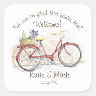 Bicicleta roja con la recepción de la cesta pegatina cuadrada