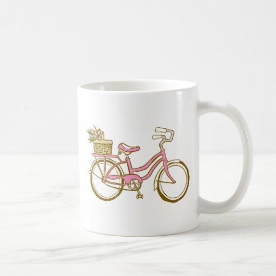 Bicicleta rosada bonita con los tulipanes taza de café
