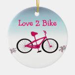Bicicleta rosada con el refrán lindo ornamentos de reyes magos