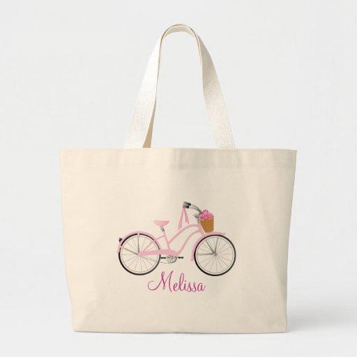 Bicicleta rosada con las flámulas bolsa de mano