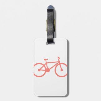 Bicicleta rosada coralina etiquetas de maletas