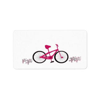 Bicicleta rosada etiquetas de dirección