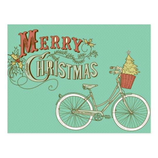 Bicicleta verde de las Felices Navidad del vintage Postal