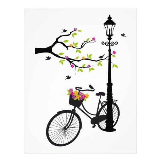 Bicicleta vieja con la lámpara, cesta de la flor,  membrete