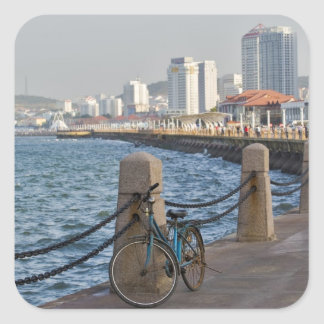 Bicycle at waterfront with Yantai city skyline, Square Sticker