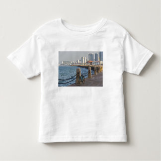 Bicycle at waterfront with Yantai city skyline, T-shirts