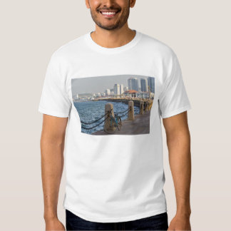 Bicycle at waterfront with Yantai city skyline, Tee Shirt