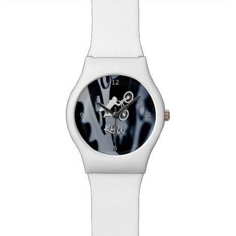 Bicycle gears and bmx stunt with monogram wristwatch