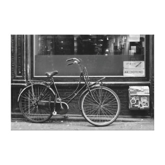 Bicycle in fornt of shop window canvas print