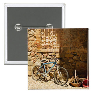 Bicycle in front of a wall, Monteriggioni, Siena Pinback Button