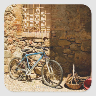 Bicycle in front of a wall, Monteriggioni, Siena Square Sticker