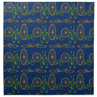 Bicycle in green and orange on blue pattern napkin