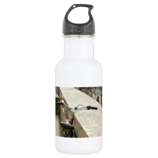 Bicycle Leaning On A Wall, City Photograph Water Bottle
