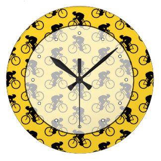 Bicycle Rider Pattern. Yellow and Black. Wallclock