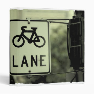 Bicycle sign in the city binder