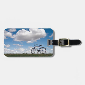 Bicycle with blue sky and clouds luggage tag