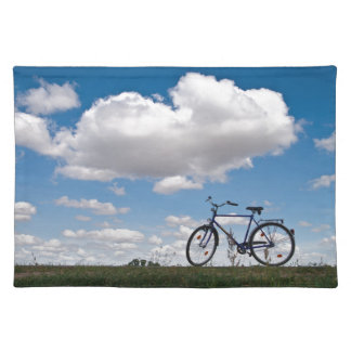 Bicycle with blue sky and clouds place mat