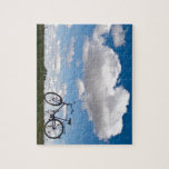 Bicycle with blue sky and clouds puzzles