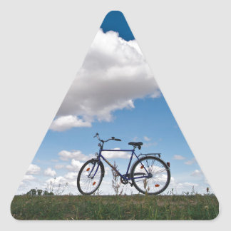 Bicycle with blue sky and clouds triangle sticker