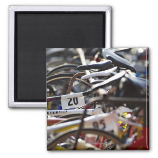 Bicycles on the rack at a triathlon race ready 2 inch square magnet