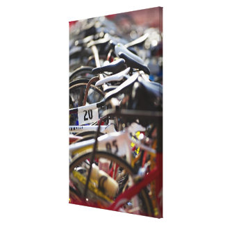 Bicycles on the rack at a triathlon race ready canvas print