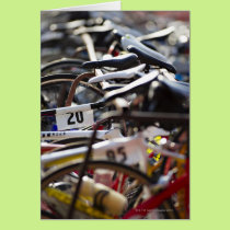 Bicycles on the rack at a triathlon race ready card