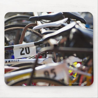 Bicycles on the rack at a triathlon race ready mouse pad