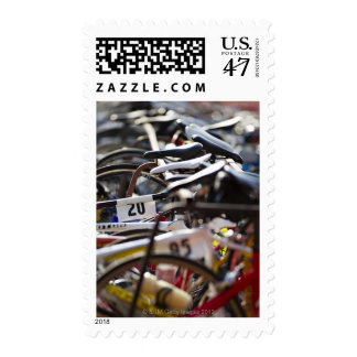 Bicycles on the rack at a triathlon race ready postage stamp