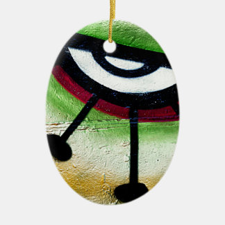 Big and colorful eye graffitti. Double-Sided oval ceramic christmas ornament