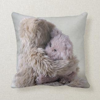 Big bear holds little bear pillow