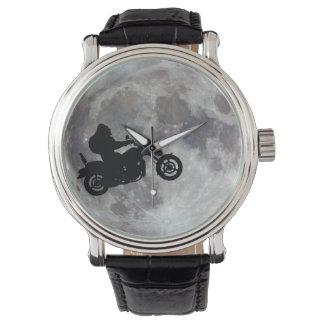 Big foot, big bike and a big bright moon wrist watch