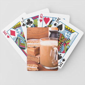 Big mug of hot cocoa with foam bicycle playing cards
