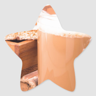 Big mug of hot cocoa with foam star sticker