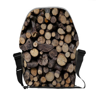 Big pile of sawn logs stacked on top of each other messenger bag
