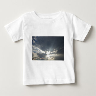 Big rays of light with many clouds and blue sky baby T-Shirt