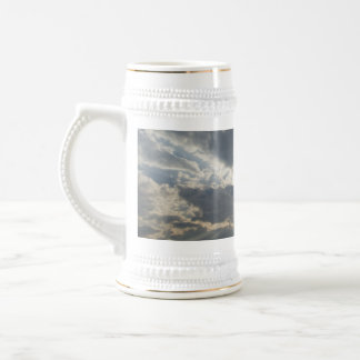 Big rays of light with many clouds and blue sky beer stein