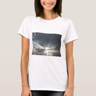Big rays of light with many clouds and blue sky T-Shirt