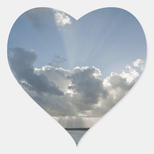 Big rays through clouds heart sticker
