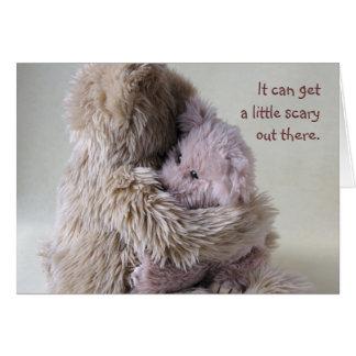 big teddy bear holds little bear card scary