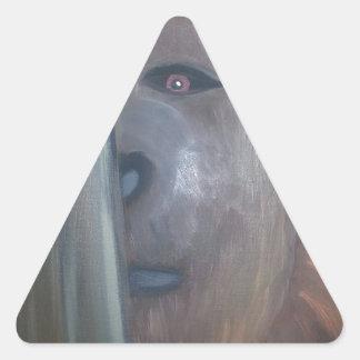 Bigfoot behind tree.jpg triangle sticker