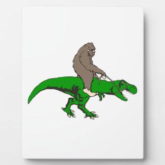 Bigfoot riding T Rex Plaque