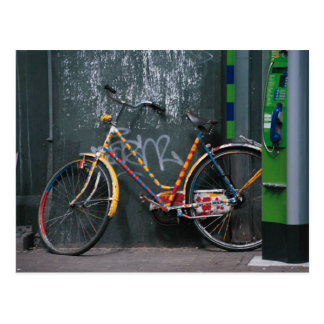 Bike Resting On Graffitti Wall Postcard