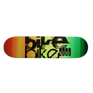 Bike; Vibrant Green, Orange, & Yellow Skateboard