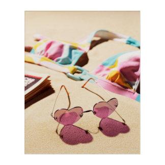 Bikini Top And Heart Shape Sunglasses On Beach Acrylic Print