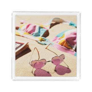 Bikini Top And Heart Shape Sunglasses On Beach Acrylic Tray