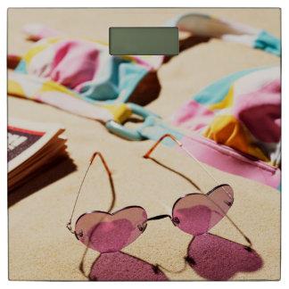 Bikini Top And Heart Shape Sunglasses On Beach Bathroom Scale